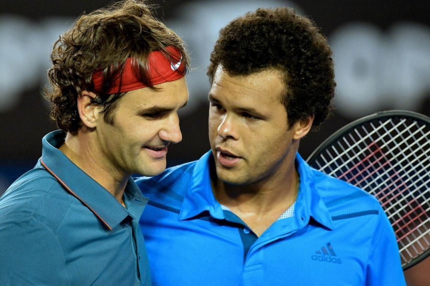 Switzerland's Roger Federer (left) celebrates after victory in his men's singles match against France's Jo-Wilfried Tsonga on day eight of the 2014 Australian Open tennis tournament in Melbourne on Jan 20, 2014.-- PHOTO: AFP