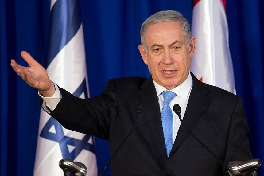 """Israeli Prime Minister Benjamin Netanyahu said on Tuesday, Jan 21, 2014, that Iran's atomic drive """"will be stopped,"""" a day after a nuclear deal bringing in sanctions relief for Tehran took effect. -- PHOTO: AFP"""