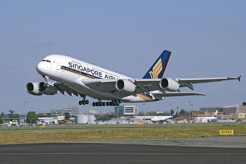 Travellers on Singapore Airlines flight SQ800 from Singapore to Beijing on Monday, Jan 21, 2014 were held for 21 minutes because of a sick three-year-old child. -- FILE PHOTO: SIA