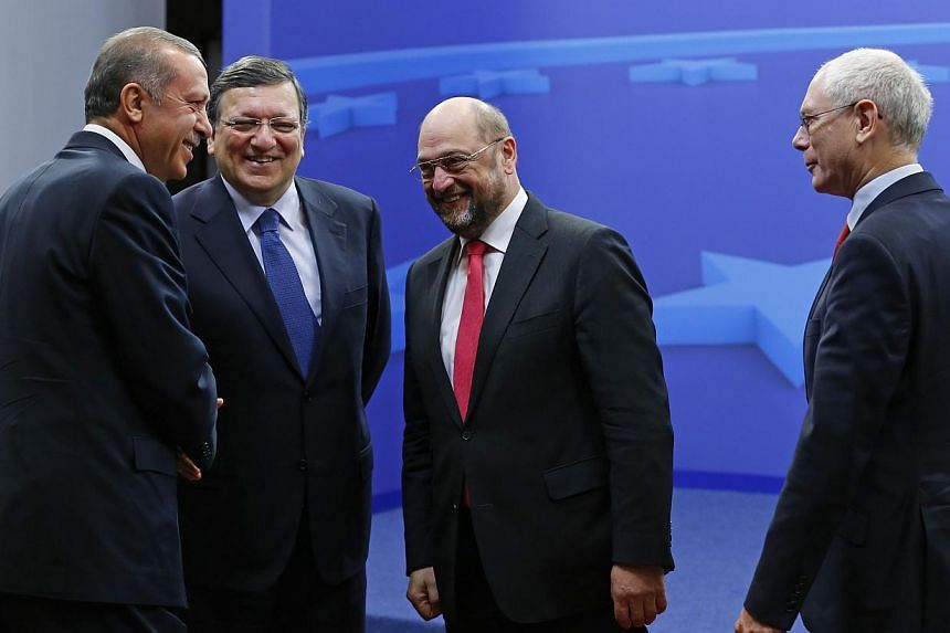 Turkey's Prime Minister Recep Tayyip Erdogan (left) is welcomed by European Commission President Jose Manuel Barroso (second left), European Parliament President Martin Schulz (second right) and European Council President Herman Van Rompuy (right) ah