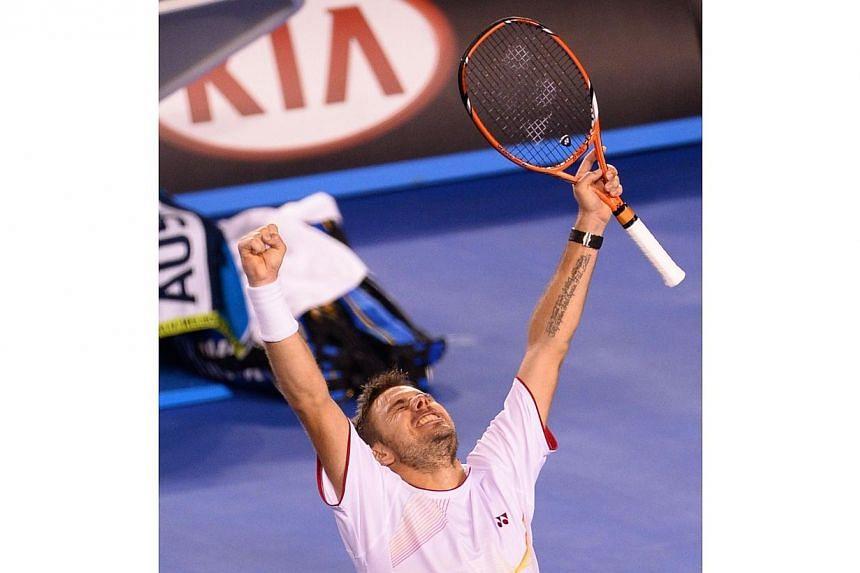 Stanislas Wawrinka dumped three-time defending champion Novak Djokovic out of tennis' Australian Open after a thrilling five-set match on Tuesday, Jan 21, 2014. -- PHOTO: AFP