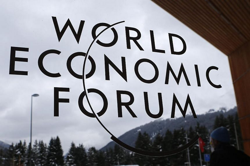A sign is pictured on a door of the Congress Centre before the start of the annual meeting of the World Economic Forum 2014 in Davos on Tuesday, Jan 21, 2014. -- PHOTO: REUTERS