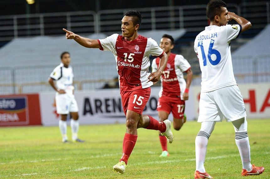 LionsXII's Sufian Anuar celebrates after scoring his side's first goal against DRB-Hicom in a Malaysian FA Cup first-round tie. Fandi Ahmad picked up his first win as coach of the LionsXII on Tuesday evening with a comfortable 3-0 victory. -- ST PHOT
