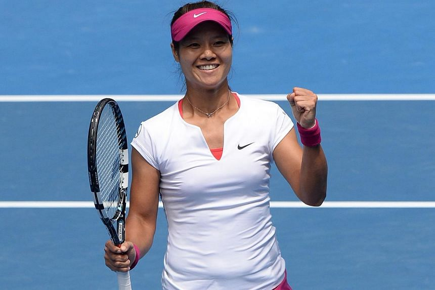 China's Li Na celebrates after victory in her women's singles match against Italy's Flavia Pennetta on day nine at the 2014 Australian Open tennis tournament in Melbourne on Jan 21, 2014. -- PHOTO: AFP