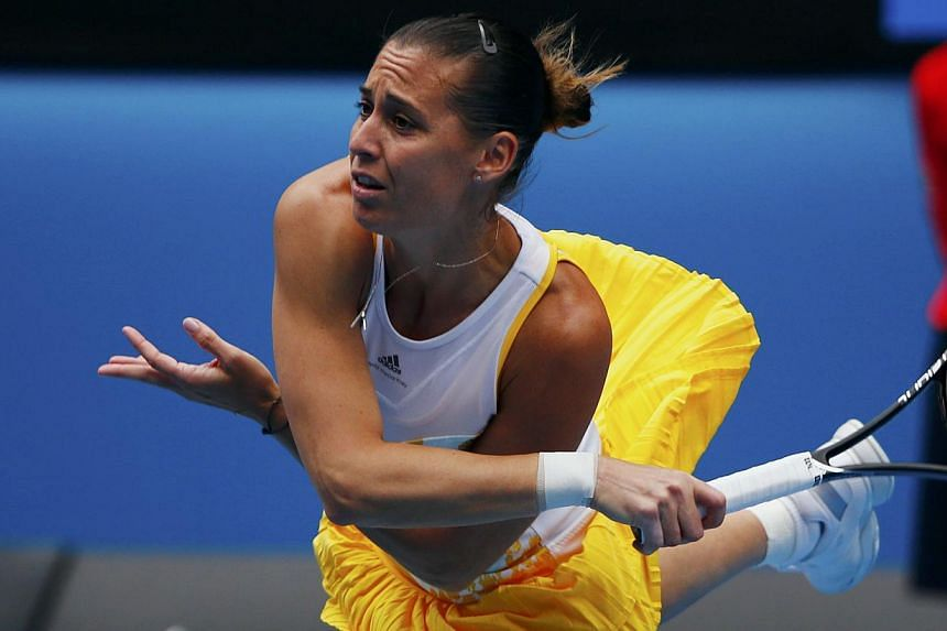 Flavia Pennetta of Italy serves to Li Na of China during their women's quarter-final tennis match at the Australian Open 2014 tennis tournament in Melbourne Jan 21, 2014.-- PHOTO: REUTERS