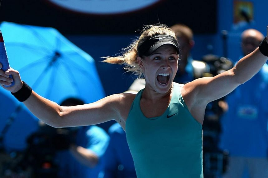 Canada's Eugenie Bouchard celebrates after victory in her women's singles match against Serbia's Ana Ivanovic on day nine at the 2014 Australian Open tennis tournament in Melbourne on Jan 21, 2014. -- PHOTO: AFP