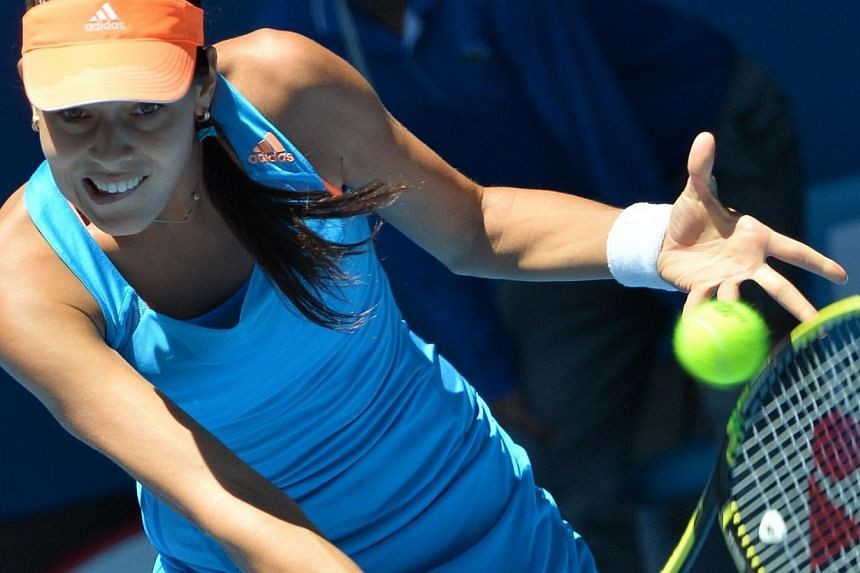 Ana Ivanovic of Serbia returns to Eugenie Bouchard of Cananda during their women's singles match on day nine of the 2014 Australian Open tennis tournament in Melbourne on Jan 21, 2014. -- PHOTO: AFP