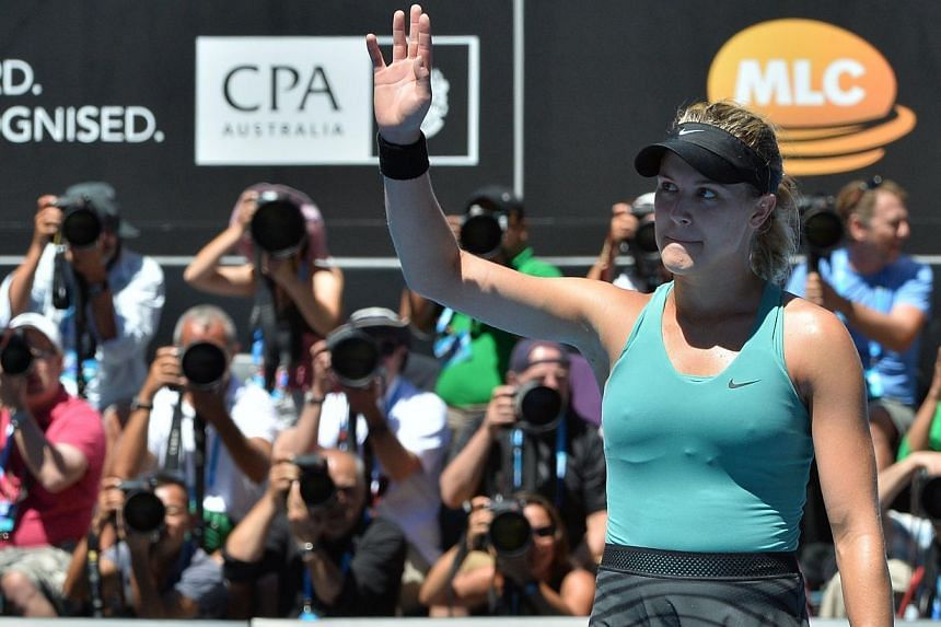 Eugenie Bouchard of Cananda celebrates her win over Ana Ivanovic of Serbia during their women's singles match on day nine of the 2014 Australian Open tennis tournament in Melbourne on Jan 21, 2014. -- PHOTO: AFP