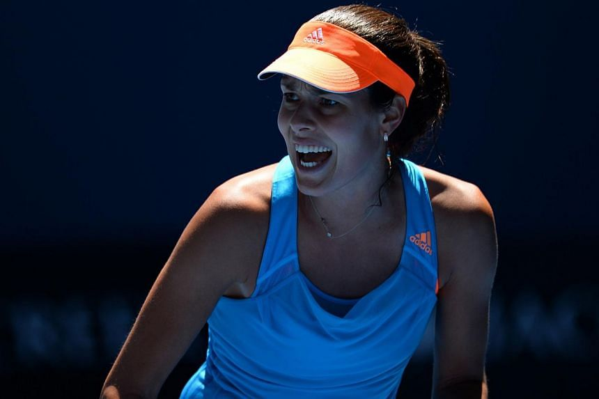 Serbia's Ana Ivanovic reacts during her women's singles match against Canada's Eugenie Bouchard on day nine at the 2014 Australian Open tennis tournament in Melbourne on Jan 21, 2014. -- PHOTO: AFP
