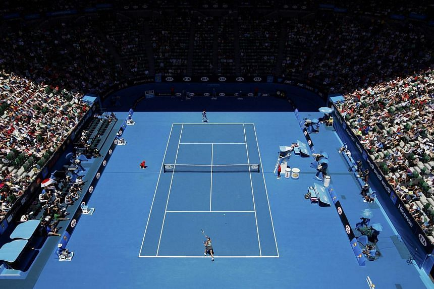 Eugenie Bouchard (bottom) of Canada hits a return to Ana Ivanovic of Serbia during their women's quarter-final tennis match at the Australian Open 2014 tennis tournament in Melbourne on Jan 21, 2014. -- PHOTO: REUTERS