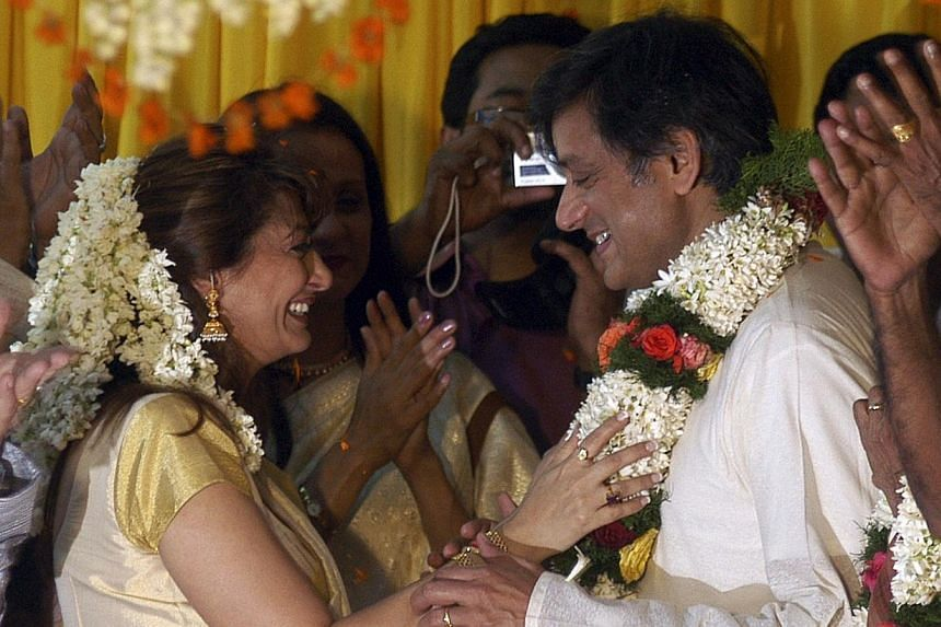 Ms Sunanda Puskhar and her husband Shashi Tharoor, India's Minister of State for Human Resource Development, share a moment during their wedding ceremony at Tharoor's house in Palakkad, in the southern Indian state of Kerala, August 22, 2010. -- FILE