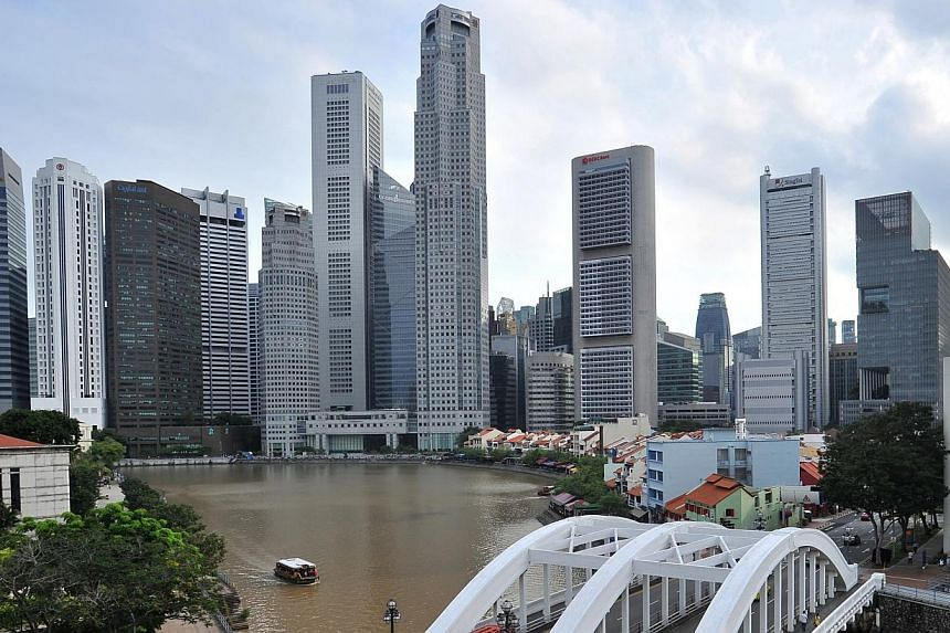 The Singapore Central Business District skyline showing skyscrapers which house offices and banks. Employees in Singapore are the unhappiest in the Asia Pacific region, a new report has found. -- ST FILE PHOTO: LIM YAOHUI