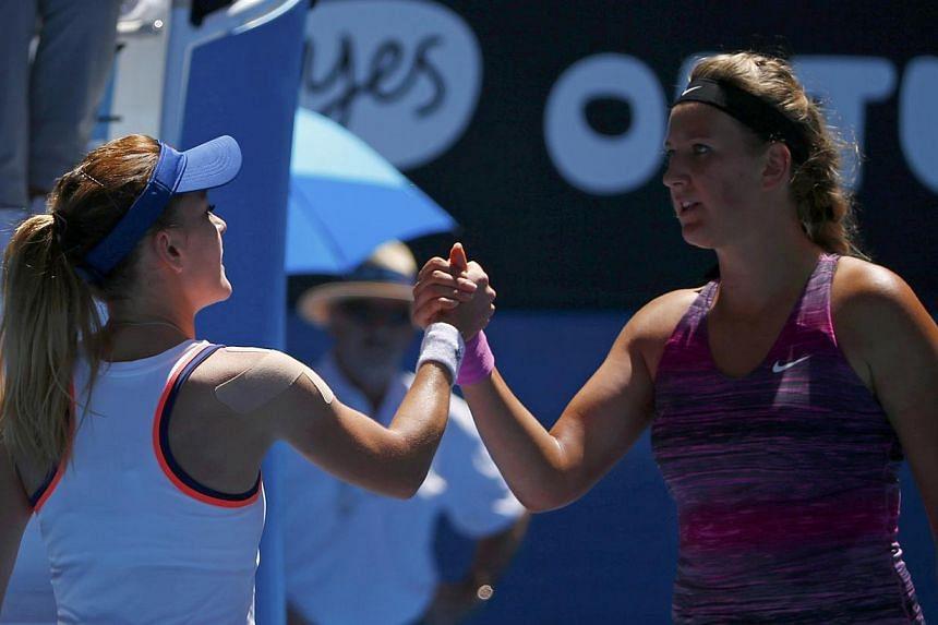 Agnieszka Radwanska of Poland (left) shakes hands with Victoria Azarenka of Belarus after their women's singles quarter-final tennis match at the Australian Open 2014 tennis tournament in Melbourne on Jan 22, 2014. -- PHOTO: REUTERS