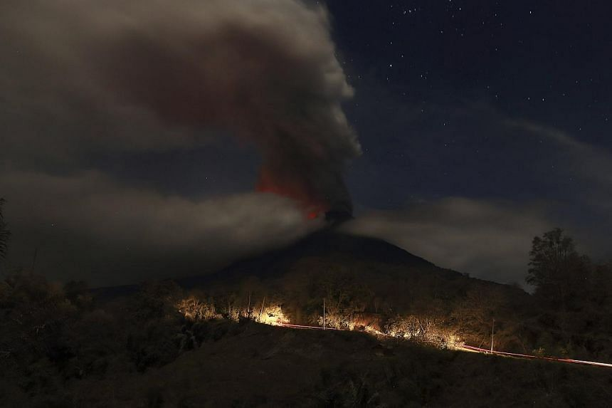Mt Sinabung is seen during an eruption from Naman Teran village in Karo district, Indonesia's North Sumatra province, Jan 20, 2014. More than 28,000 villagers have been evacuated since authorities raised the alert status for the volcano to the highes