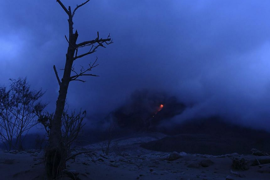Pyroclastic flow glows red during the eruption of Mt Sinabung near Sigarang Garang village in Karo district, Indonesia's North Sumatra province, Jan 19, 2014. More than 28,000 villagers have been evacuated since authorities raised the alert status fo