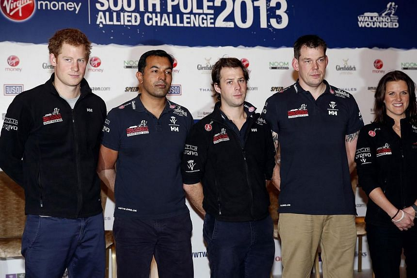 Britain's Prince Harry (left) poses with other members of the Walking With The Wounded South Pole Allied Challenge 2013 team Ibrar Ali, Guy Disney Duncan Slater and Kate Philp, following a welcome home news conference in central London on Jan 21, 201