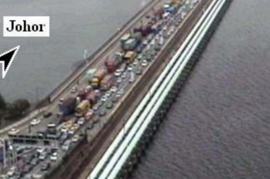 Singapore-bound traffic on the Causeway was crawling at noon on Wednesday, a day after police and immigration authorities said a Malaysian woman motorist managed to sneak into Singapore at the checkpoint by tailgating a vehicle. -- SCREENGRAB: ONEMOT