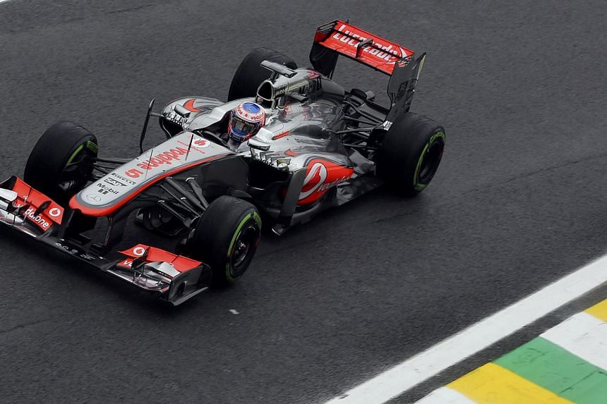 McLaren Formula One driver Jenson Button of Britain drives during the qualifying session of the Brazilian F1 Grand Prix at the Interlagos circuit in Sao Paulo on Nov 23, 2013.The McLaren Formula One team have not found a new title sponsor to re
