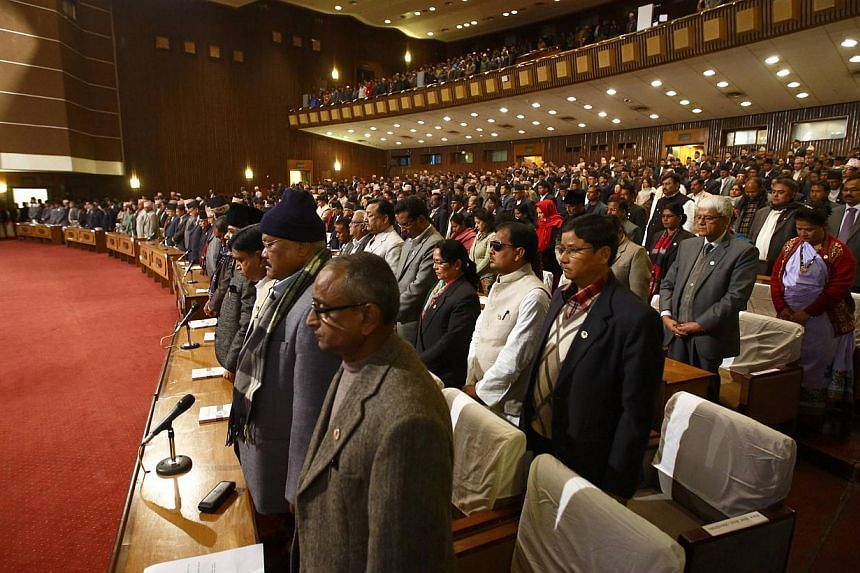 Newly elected members of Nepal's Constituent Assembly attend the first parliament meeting after November elections, in Kathmandu on January 22, 2014. The new assembly is elected to write a constitution after the abolition of the 240-year-old feudal m