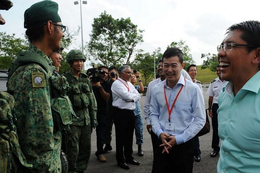 Minister of State for Defence Maliki Osman (right) and members of the Government Parliamentary Committee (GPC) for Defence and Foreign Affairs interacting with SPYDER operators after the demonstration. Members of the GPC, and its Resource Panel, visi