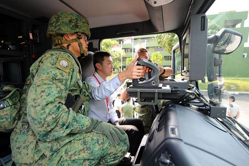 Dr Lim Wee Kiak, chairman of the GPC for Defence and Foreign Affairs, being briefed on how the SPYDER is deployed. -- PHOTO: MINDEF
