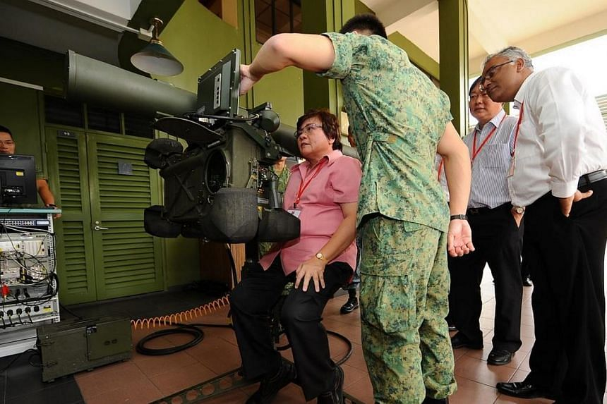 GPC for Defence and Foreign Affairs deputy chairman Ellen Lee trying out the RBS-70 GBAD simulator. -- PHOTO: MINDEF