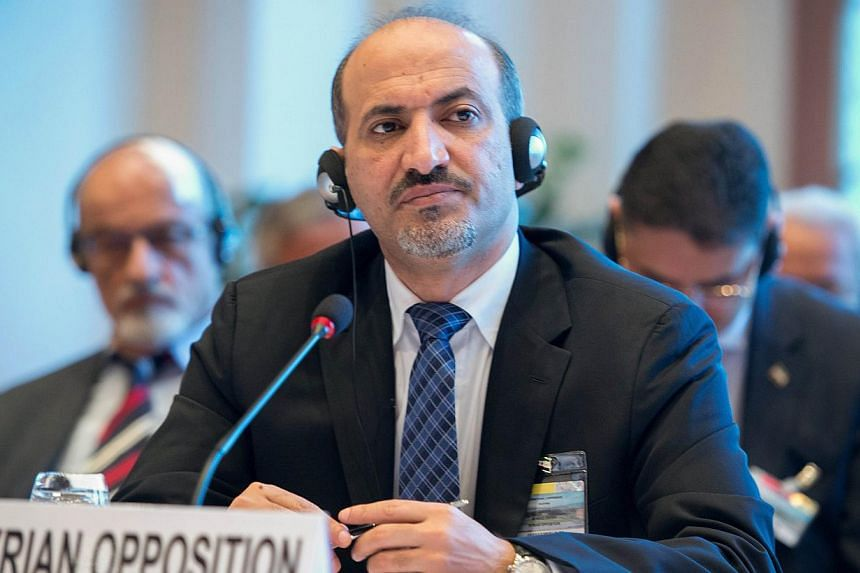 Syrian National Coalition (SNC) leader Ahmad Jarba at the start of the so-called Geneva II peace talks, on Jan 22, 2014, in Montreux.The Syrian opposition leader on Wednesday, Jan 22, 2014, called on President Bashar al-Assad to hand over power