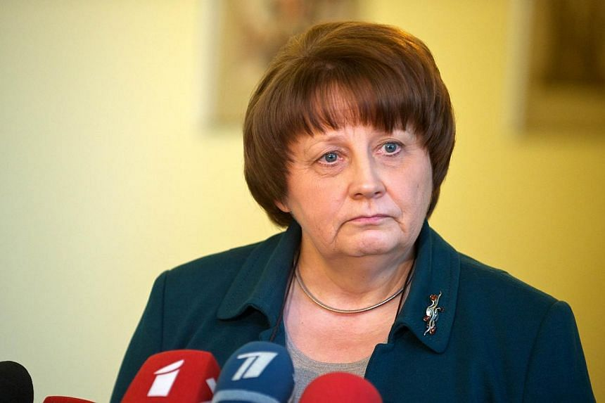 Newly appointed Latvian Prime Minister Laimdota Straujuma addresses journalists after a meeting on the forming of a new government in Riga, Latvia, on Jan 8, 2014. Latvia's parliament on Wednesday, Jan 22, 2014, gave the green light to a new centre-r