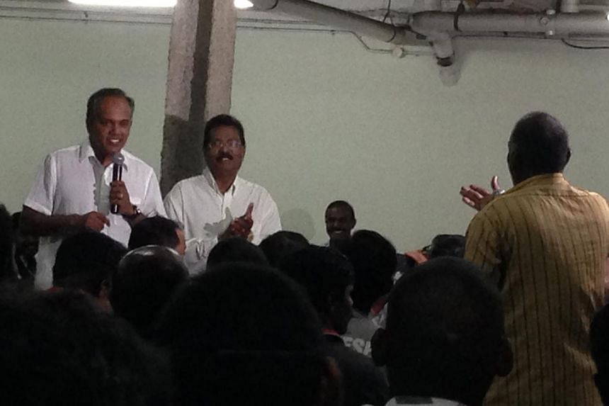 Mr K. Shanmugam speaking to workers at the Terusan Lodge dormitory in Jurong on Wednesday night, Jan 22, 2014.The government has a duty to do what it can to prevent last December's Little India riot from happening again, said Minister for Law a