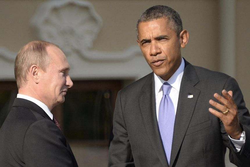 """Russia's President Vladimir Putin (left) welcomes United States President Barack Obama at the start of the G20 summit inSaint Petersburg on Sept 5, 2013. MrObama and Mr Putin discussed on Jan 21, 2014, how to ensure """"a safe and secure S"""