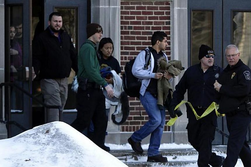 Students walk out of the Electrical Engineering Building at Purdue University in West Lafayette, Indiana January 21, 2014. -- PHOTO: REUTERS