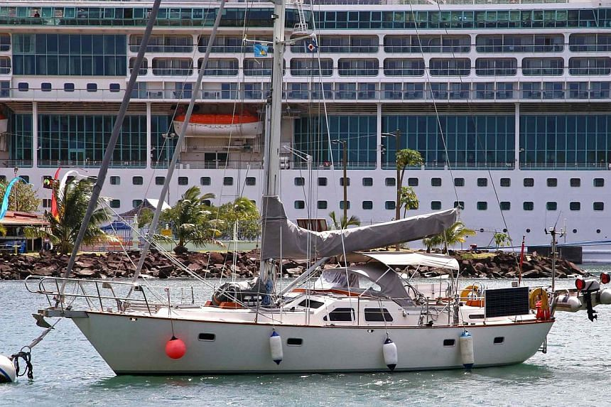 Sailboat Magnetic Attraction, belonging to British couple Roger and Margaret Pratt, sits in Ganter's Bay just off a police base at Castries Harbour in St. Lucia Jan 20, 2014. Authorities on the Caribbean island of St. Lucia said they have arrested fi