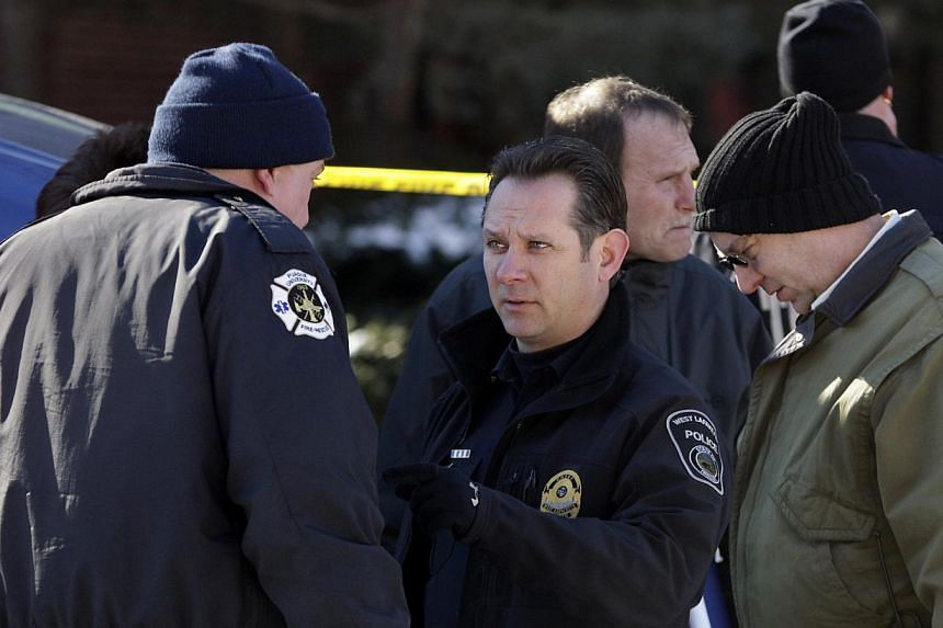 West Lafayette Police Chief Jason Dombkowski (centre) talks with other officers at Purdue University in West Lafayette, Indiana, on Jan 21, 2014. One person is dead and one suspect in custody after a shooting at the university in what appeared to be