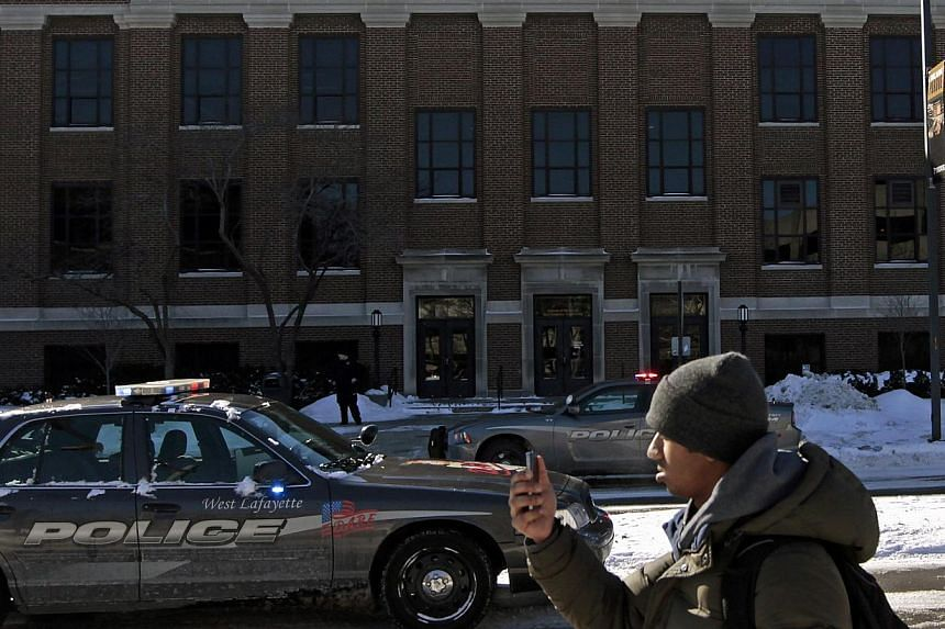 A student walks past the Electrical Engineering building at Purdue University in West Lafayette, Indiana, on Jan 21, 2014. One person is dead and one suspect in custody after a shooting at the university in what appeared to be a targeted attack at a