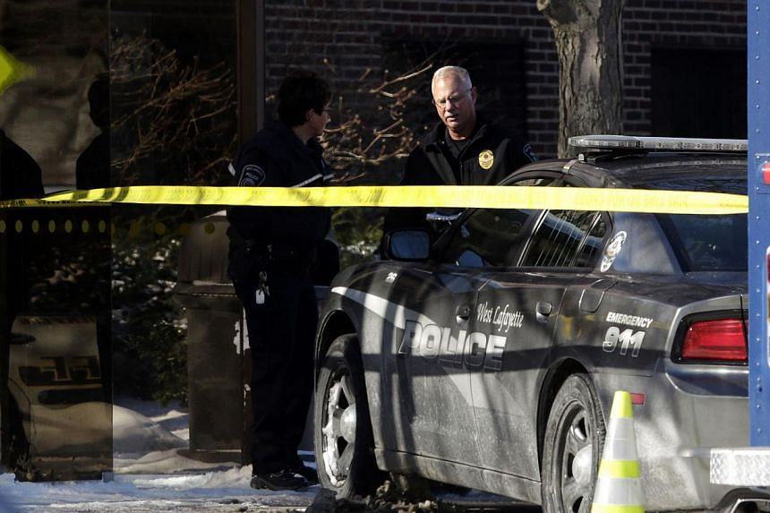 Officers survey the scene of a shooting at Purdue University in West Lafayette, Indiana, on Jan 21, 2014. One person is dead and one suspect in custody after a shooting at the university in what appeared to be a targeted attack at a specific person,