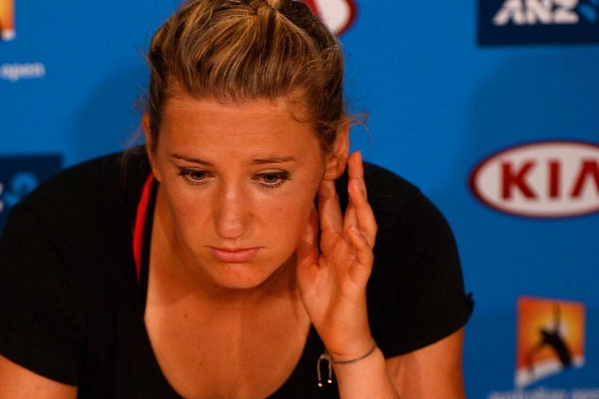Victoria Azarenka of Belarus listens to a question at a press conference after losing her women's singles match to Agnieszka Radwanska of Poland on day 10 of the 2014 Australian Open tennis tournament in Melbourne on Jan 22, 2014. -- PHOTO: AFP