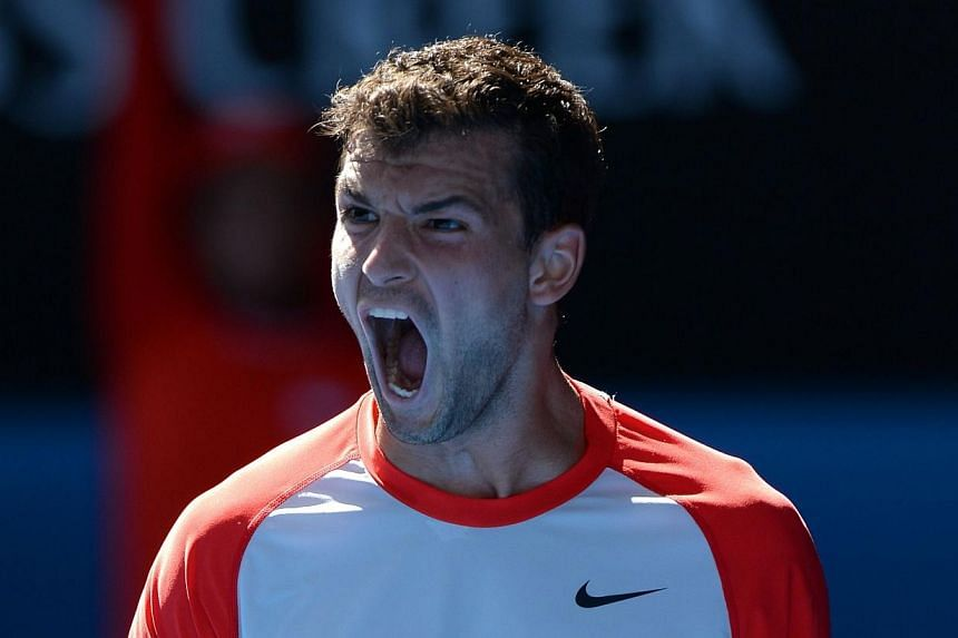Bulgaria's Grigor Dimitrov shouts during his men's singles match against Spain's Rafael Nadal on day ten of the 2014 Australian Open tennis tournament in Melbourne on Jan 22, 2014. -- PHOTO: AFP