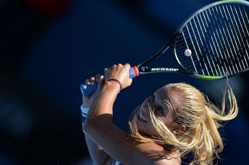 Slovakia's Dominika Cibulkova plays a shot during her women's singles match against Romania's Simona Halep on day ten of the 2014 Australian Open tennis tournament in Melbourne on Jan 22, 2014. -- PHOTO: AFP