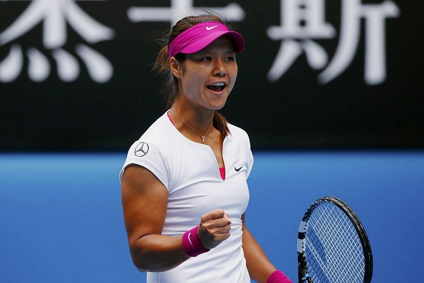 Li Na of China reacts during her women's quarter-final tennis match against Flavia Pennetta of Italy at the Australian Open 2014 tennis tournament in Melbourne Jan 21, 2014. -- PHOTO: REUTERS