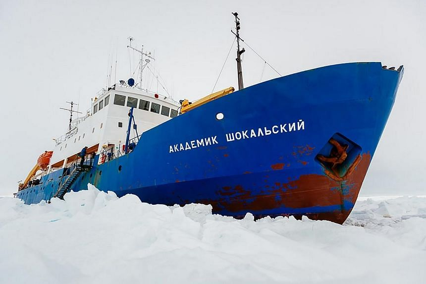 This handout image released by the Centre of Excellence for Climate System Science at the University of New South Wales taken on Dec 27, 2013 shows the ship MV Akademik Shokalskiy trapped in the ice at sea off Antarctica.Scientists whose Antarc