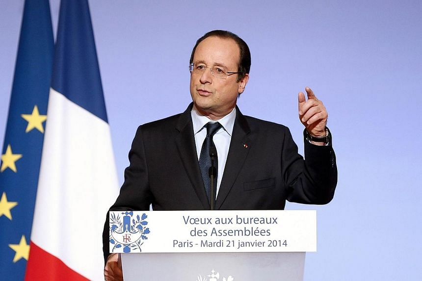 French President Francois Hollande delivers a speech to present his New Year wishes to members of Parliament in Paris, on Jan 21, 2014. Mr Hollande expressed serious concern over the increasing violence in Ukraine and urged the government to ens