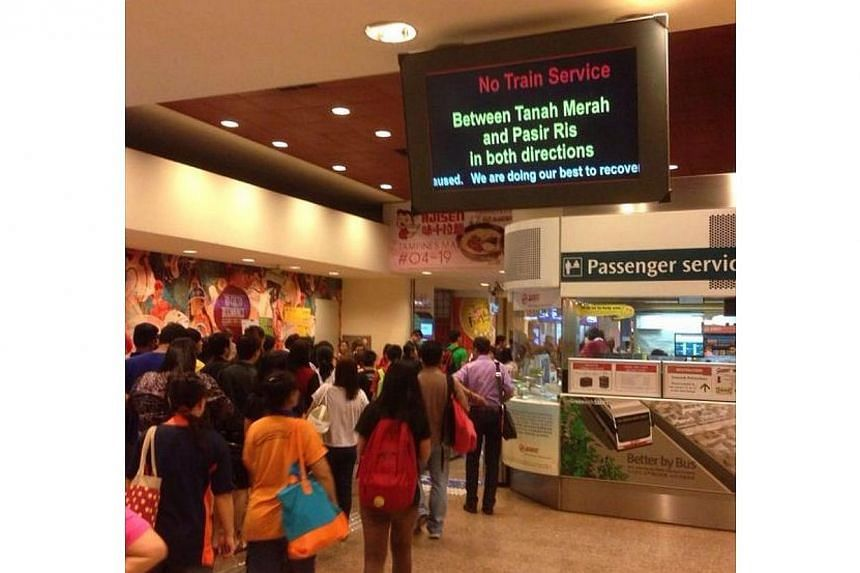 Train service between Tampines and Tanah Merah on the East-West line was disrupted on Wednesday night, at about 10pm but was back up again before 11.30pm. -- PHOTO: AZIZ YUSOFF