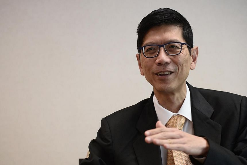 In a boost for Asian universities, National University of Singapore president Tan Chorh Chuan (above) has been appointed by the World Economic Forum as chair of a prestigious forum of university leaders.-- ST PHOTO:MARK CHEONG
