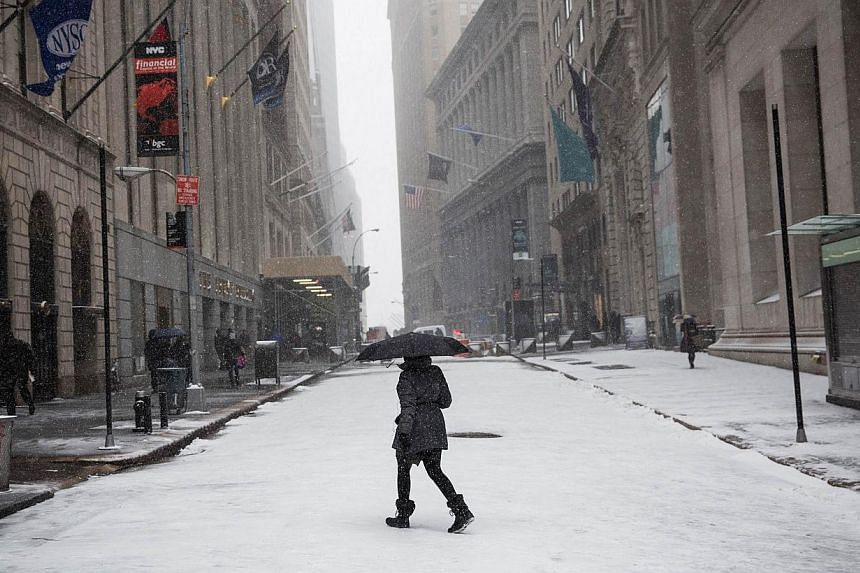 A woman walks through a snowstorm that is moving through the north-east on Jan 21, 2014 in New York City. -- PHOTO: AFP