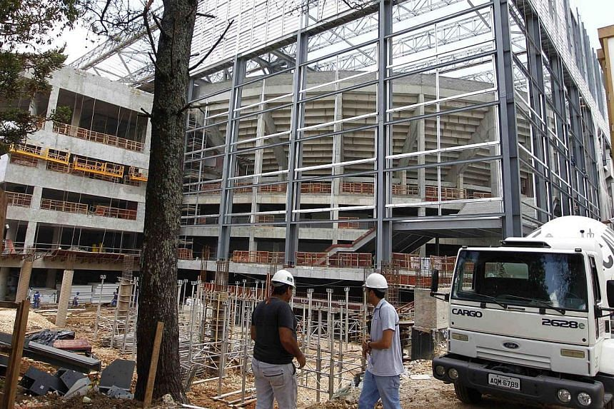 Part of the Arena da Baixada soccer stadium, which is being rebuilt for the 2014 World Cup, is pictured during a visit by Fifa Secretary General Jerome Valcke in Curitiba on Jan 21, 2014. Curitiba risks being dropped as a venue for this year's World
