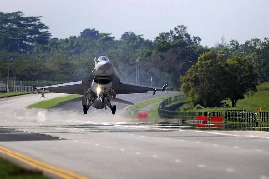 This 2008 file photo depicts a F16 fighter jet as it prepares to land on the Lim Chu Kang road during a military exercise held by the Republic of Singapore Air Force (RSAF). -- PHOTO: SPH