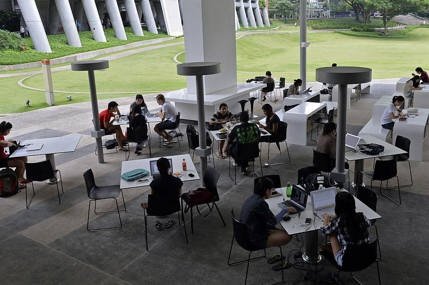 By doing away with grades, the National University of Singapore hopes that freshmen can venture out of their comfort zone and take on more ''exploratory'' type of courses. -- ST FILE PHOTO