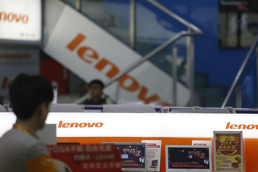 A man walks past a Lenovo shop in Shanghai, on Jan 21, 2014.Chinese computer giant Lenovo will buy IBM's low-end server business for $2.3 billion (S$2,9 billion), it said on Thursday, giving it a platform to compete in that sector with United S