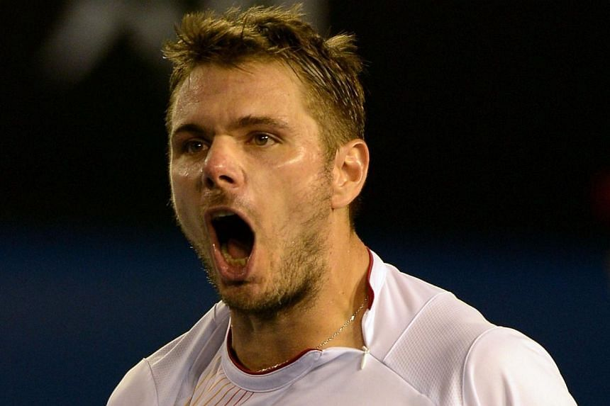 Stanislas Wawrinka of Switzerland celebrates his win over Tomas Berdych of the Czech Republic during their men's singles semi-final match on day 11 of the 2014 Australian Open tennis tournament in Melbourne on Thursday, Jan 23, 2014..-- PHOTO:
