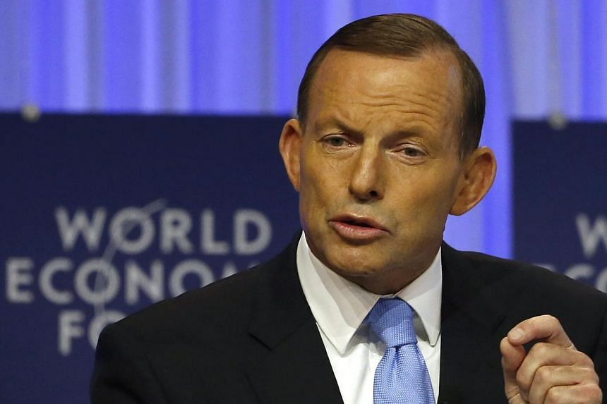 Australia's Prime Minister Tony Abbott speaks during a session at the annual meeting of the World Economic Forum (WEF) in Davos, on Jan 23, 2014. Prime Minister Abbott vowed on Thursday to use his country's presidency of the G20 this year to promote